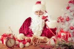 Santa Claus talking by phone Stock Photos