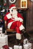 Santa claus talking to smart phone Royalty Free Stock Photos