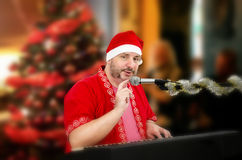 Santa Claus tapping microphone Stock Photography