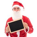 Santa Claus tenant un conseil avec Copyspace, d'isolement sur le blanc, c Photos stock