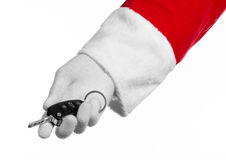 Santa Claus theme: Santa's hand holding the keys to a new car on a white background Royalty Free Stock Photography