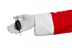 Santa Claus theme: Santa's hand holding the keys to a new car on a white background Royalty Free Stock Photos