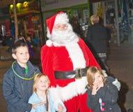 Santa Claus with three smiling children. Royalty Free Stock Photos