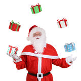 Santa Claus throwing Christmas gifts isolated Royalty Free Stock Photo