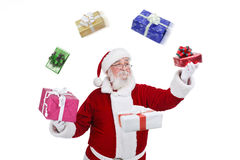 Santa Claus throwing and playing with presents Royalty Free Stock Photography