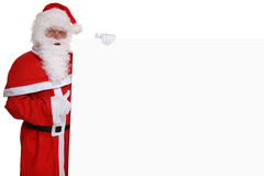 Santa Claus thumbs up on Christmas holding empty banner Stock Photos