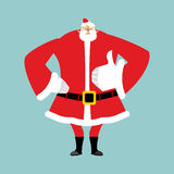 Santa Claus thumbs up. Gesture of hand is all right. Success of Royalty Free Stock Image