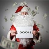 Santa Claus tient un livre blanc dans des ses mains Un million de d Images stock