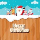 Santa Claus, Tiere auf hölzernem Zaun Stockfoto