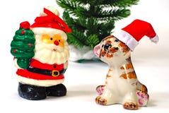 Santa Claus and tiger and  christmas tree Stock Photos