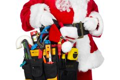 Santa Claus with a tool belt. Santa Worker with a tool belt over white background stock photo