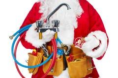 Santa Claus with a tool belt. Stock Photos