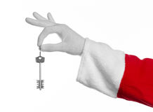 Santa Claus topic: Hand santa holds the keys to a new apartment or a new house on a white background Royalty Free Stock Photo