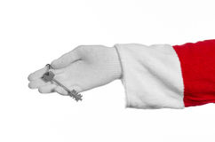 Santa Claus topic: Hand santa holds the keys to a new apartment or a new house on a white background Stock Photos