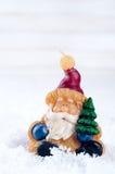 Santa Claus toy brings Christmas tree Stock Photos