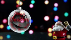 Santa Claus Merry Christmas and Happy New Year. Close up with bell with lights in the background. stock video footage