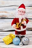 Santa Claus toy with Cristmas gift. stock photos