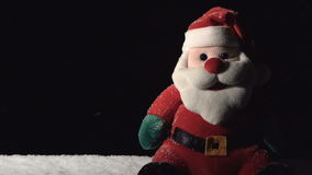 Santa Claus Toy with Falling Snow stock footage