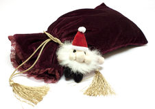 Santa Claus toy and fancy luxury gift bag Royalty Free Stock Images