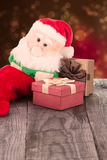 Santa Claus toy and the gift boxes Stock Image