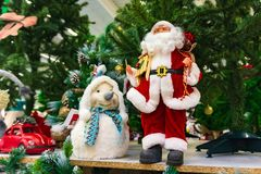 Christmas toy, the Snow Maiden next to Santa Claus. stock photography
