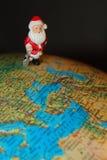 Santa claus toy on globe  Stock Image