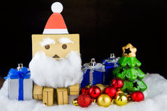 Santa Claus toy happiness in Christmas day. Royalty Free Stock Photo