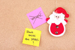 Santa Claus toy and paper notes on board Stock Photos