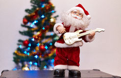 Santa Claus toy playing guitar Royalty Free Stock Image