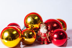 Santa Claus toy with red and gold  balls Stock Photography