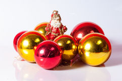 Santa Claus toy. With red and gold  balls decoration Royalty Free Stock Image