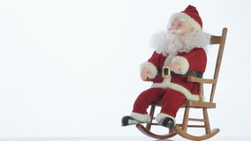 Santa Claus toy rocking in a rocking chair stock video