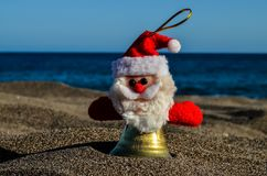 Santa Claus Toy on the Sand Beach. Photo Picture of Santa Claus Toy on the Sand Beach royalty free stock images