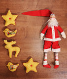Santa Claus and toys on a wooden background with empty space. Santa Claus and textile toys on a wooden background with empty space Stock Photos