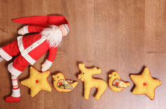 Santa Claus and toys on a wooden background with empty space. Santa Claus and textile toys on a wooden background with empty space Stock Image