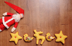 Santa Claus and toys on a wooden background with empty space. Santa Claus and textile toys on a wooden background with empty space Royalty Free Stock Photography