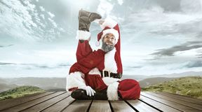 Santa Claus with traditional red white costume in front of white snow winter landscape panorama. Santa Claus in traditional red white costume in front of white royalty free stock photo