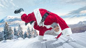 Santa Claus with traditional red white costume in front of white snow winter landscape panorama. Santa Claus in traditional red white costume in front of white royalty free stock photography