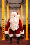 Strong man - Santa Claus training before Christmas. Santa Claus training before Christmas in gym - kettlebells royalty free stock photos