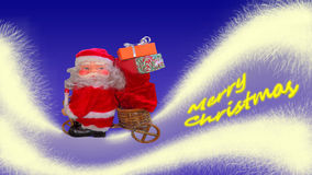 Santa Claus is transporting gifts Stock Image