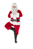 Santa claus in tree pose Royalty Free Stock Image
