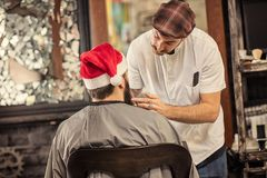 Santa Claus trimming beard. From barber stock photo
