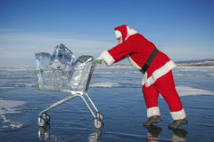 Santa Claus with a trolley of pure ice at winter Baikal lake Stock Photos