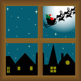 Santa claus trough the window. Image of santa claus over the little village, with the moon behind him Stock Photography