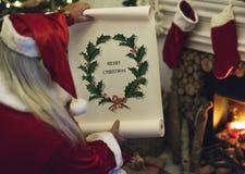Santa Claus trzyma Wesoło bożych narodzeń papieru rolkę Obraz Royalty Free