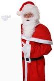 Santa Claus tummar upp på jul som rymmer det tomma banret med snuten Fotografering för Bildbyråer