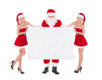 Santa Claus and two happy cute Snow Maiden women with christmas Stock Image