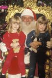 Santa Claus with Two Little Girls, Santa Monica, California Stock Images
