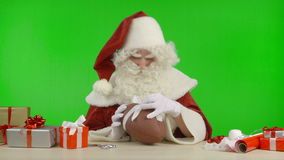 Santa Claus is Tying a Bow on a Baseball stock footage
