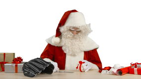 Santa Claus is Tying a Bow stock video footage